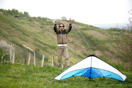 Man trying to flying kite from ground with wind Stock Photo - 4717964