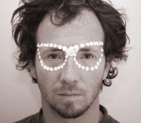 Weird young man wearing strange cream glasses Stock Photo - 4716037