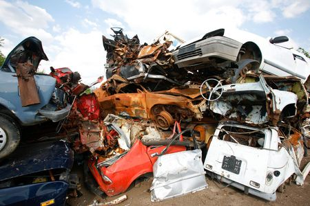 Cars piled on top of each other in junkyard Stock Photo - 5690009