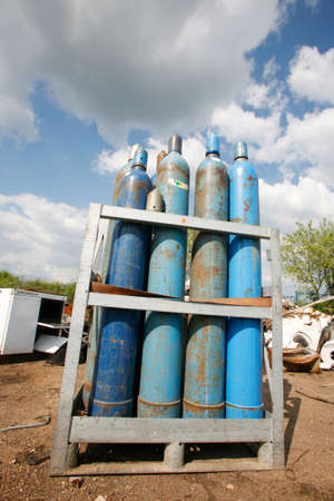 Blue gas bottles stored in junkyard site Stock Photo - 5690177