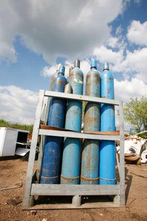 Blue gas bottles stored in junkyard site Stock Photo - 5690177