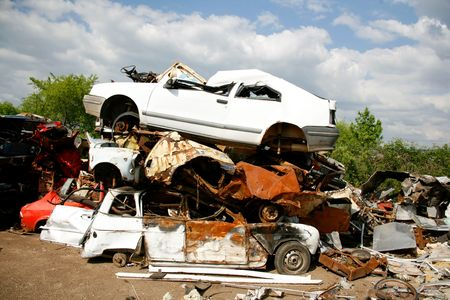 Cars piled on top of each other in junkyard Stock Photo - 5690037