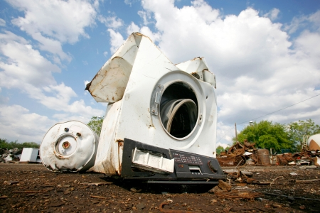 dump yard: Old household appliances disposed of in metal scrapyard Stock Photo