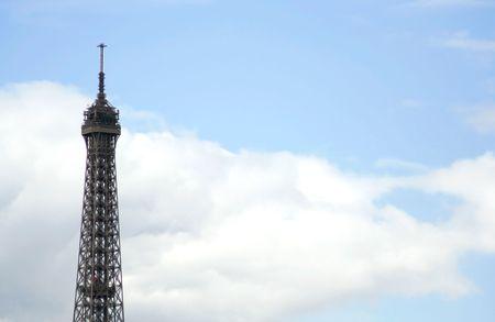 peaking: Eiffel tower peaking into the parisian sky