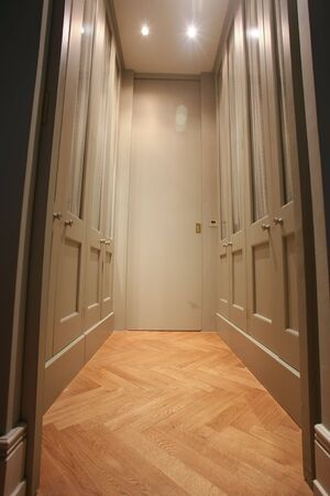 closet door: Modern walk-in wardrobe with wooden parquet floor Stock Photo