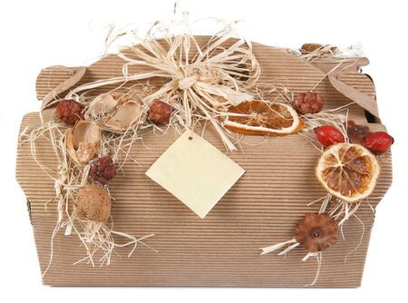 Decorated gift box with dried fruit and ribbon photo