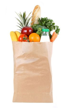pastry bag: Brown paper shopping bag filled with fresh fruit and vegetables Stock Photo