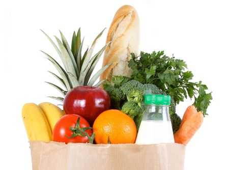 diet product: Brown paper shopping bag filled with fresh fruit and vegetables Stock Photo