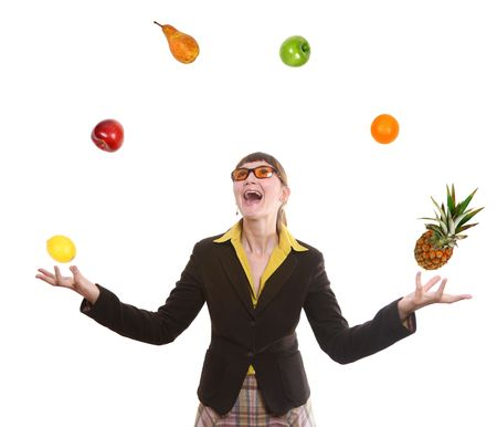 happy business woman juggling fruit on white background Stock Photo
