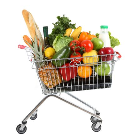 supermarket trolley: metal shopping trolley filled with products isolated on white