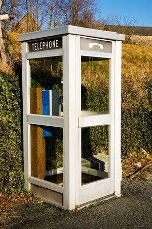 phonebooth: a white french phone booth in a rural surrounding Stock Photo