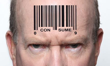 Angry consumer with a bar code on his forehead photo