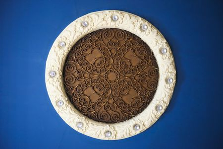 Ceiling plaster molding and iron cast design on blue background