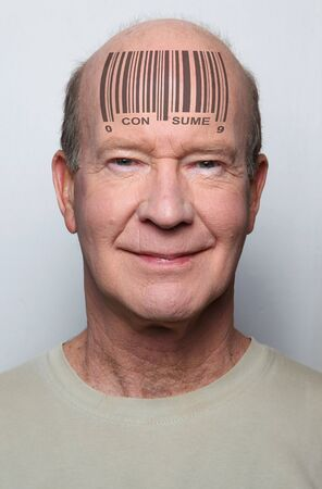 Happy and ignorant  consumer with a bar code on his forehead Stock Photo - 6668608