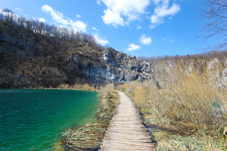 Wooden pathway through the falls at plitvice lakes in croatia photo