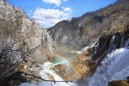 Rainbow over the plitvice national park waterfalls photo