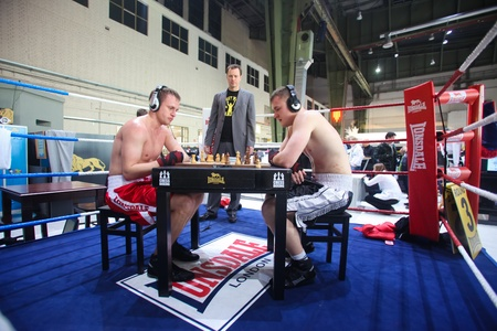 templehof: BERLIN - JANUARY 19:  Chessboxing at Bread & Butter fair on January 19, 2011 in Berlin, Germany. Tens of thousands of visitors attended the tradeshow this year. Editorial