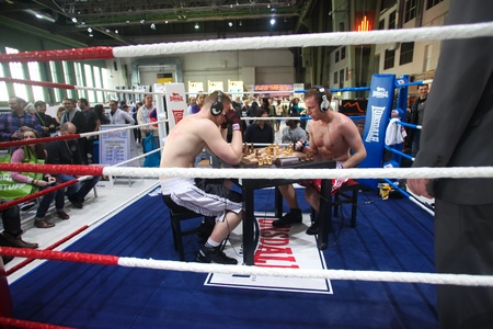 BERLIN - JANUARY 19:  Chessboxing at Bread & Butter fair on January 19, 2011 in Berlin, Germany. Tens of thousands of visitors attended the tradeshow this year. Editorial