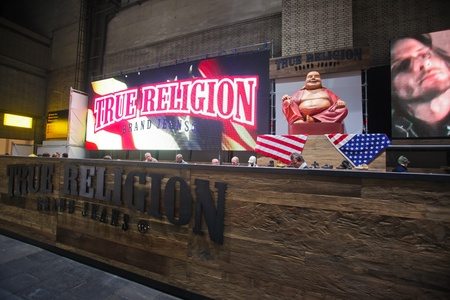 templehof: BERLIN - JANUARY 19:  True religion stand at Bread & Butter fair on January 19, 2011 in Berlin, Germany. Tens of thousands of visitors attended the tradeshow this year. Editorial