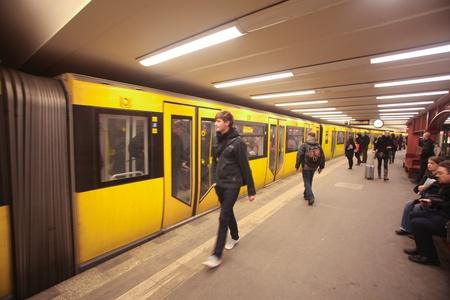 BERLIN - JANUARY 18: Passengers waiting u-bahn on January 18, 2011 in Berlin, Germany. Nearly 1 million passengers use the metro daily.