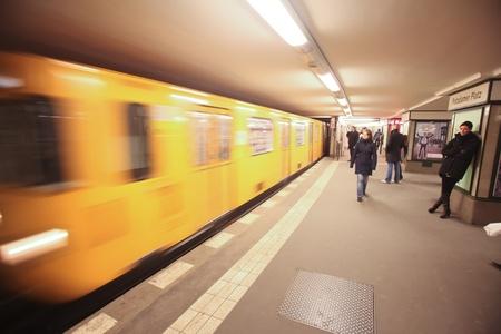 u bahn: underground train rushing into station