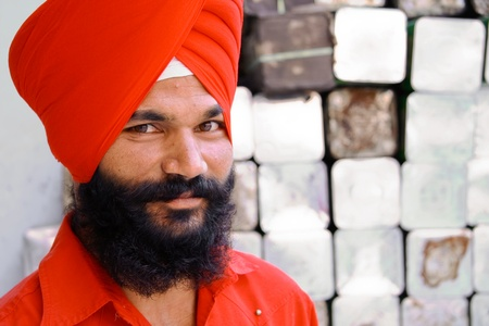 gurudwara: DELHI - SEPTEMBER 22:  Young fashionable Sikh with red turban at Sis Ganj Gurdwara on September 22, 2007 in Delhi, India. Worldwide there are about 25 million Sikhs.