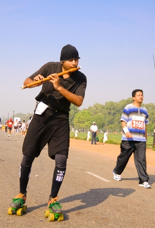 DELHI - October 28: Young man rollerskating and playing flute while participating in marathon on October 28th, 2007 in Delhi, India.