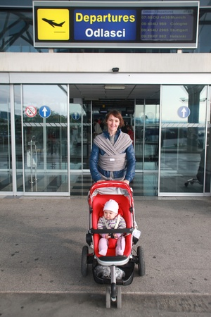 Mother and child in push chair at airport photo