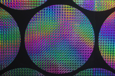 holographic: Circular holographic patterns of on background