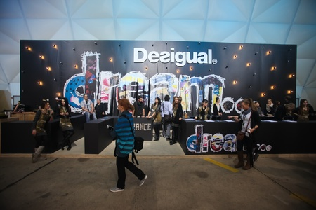 templehof: BERLIN - JANUARY 21:  Desigual stand at Bread & Butter fair on January 21, 2011 in Berlin, Germany. Tens of thousands of visitors attended the tradeshow this year.