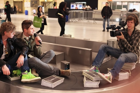 each year: BERLIN - JANUARY 21: Designer interviews on conveyor belt at Bread & Butter fair on January 21, 2011 in Berlin, Germany. Tens of thousands of visitors come each year. Editorial