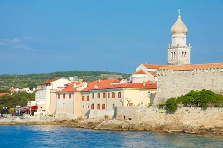 krk: Seaview of fortifications and church of Krk village on Krk island in Croatia Editorial