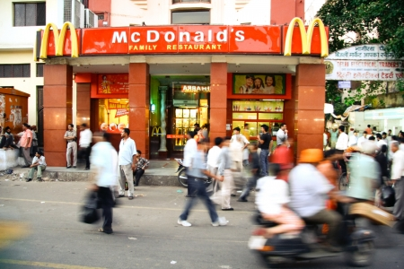 mcdonalds: DELHI - SEPTEMBER 15: Crowds passing infront of McDonalds on September 15, 2007 in Delhi, India. Its the only country in the world that does not offer beef on its menu.