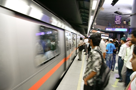DELHI - SEPTEMBER 17: passengers waiting metro train on September 17, 2007 in Delhi, India. Nearly 1 million passengers use the metro daily.