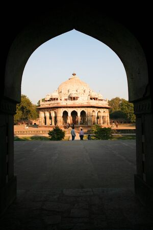 view through: DELHI - FEBRUARY 11: View through archway to people in gardens at Humayun Tomb on February 11, 2008 in Delhi, India. Declared a UNESCO World Heritage Site in 1993. Editorial