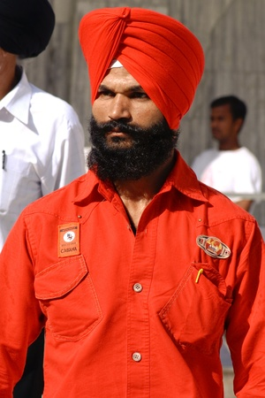 gurudwara: DELHI - SEPTEMBER 22:  Young Sikh with red turban at Sis Ganj Gurdwara on September 22, 2007 in Delhi, India. Worldwide there are about 25 million Sikhs.