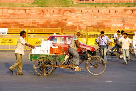 delhi: DELHI - SEPTEMBER 22: Transporting packages through city on bicycle trailer on September 22, 2007 in Delhi, India. Human labor is still cheaper than automated transport. Editorial