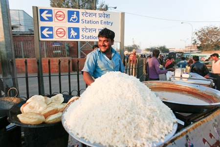 DELHI - FEBRUARY 12: Man selling rice at a street stall outside the station on February 12, 2008 in Delhi, India. Culturally, many Indians buy food from street vendors.