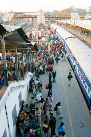 DELHI - FEBRUARY 12:  Crowded train station platform on February 12, 2008 in Delhi, India. Indian railways transport 20 million passengers daily.
