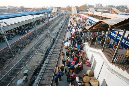 DELHI - FEBRUARY 12:  Crowded train station platform on February 12, 2008 in Delhi, India. Indian railways transport 20 million passengers daily.