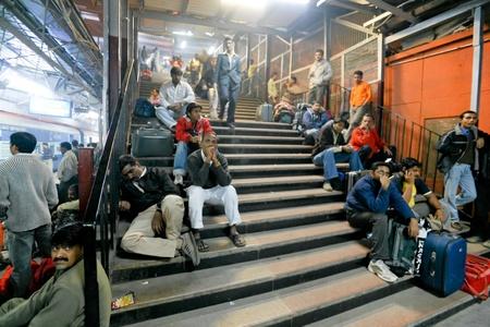 DELHI - FEBRUARY 19: Crowded train station platform on February on February 19, 2008 in Delhi, India. Indian railways transport 20 million passengers daily.
