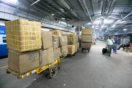DELHI - FEBRUARY 19: Cargo waiting to be loaded onto train on February 19, 2008 in Delhi, India. Indian railways transports more than 2 million tonnes of freight daily.