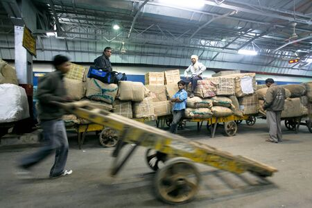 DELHI - FEBRUARY 19: Cargo being loaded onto train on February 19, 2008 in Delhi, India. Indian railways transports more than 2 million tonnes of freight daily.