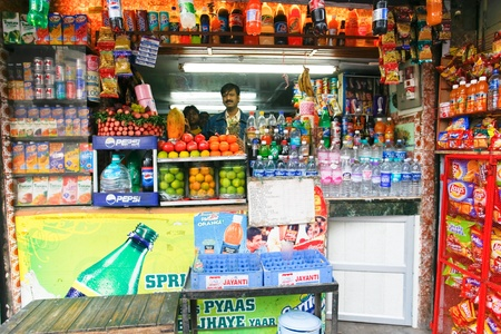 DELHI - FEBRUARY 26: Juice stall owner selling fresh fruit juices on February 26, 2008 in Dehli, India. Fresh juices are great alternatives to polluted drinking water in India.