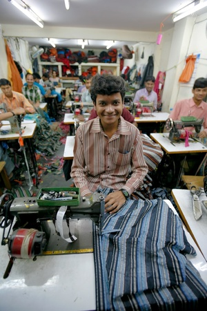 INDIA - FEB 26: Textile workers in a small factory in Old Delh on February 26, 2008 in Delhi, India. Many small factories provide the West with their clothes. Stock Photo - 8945311