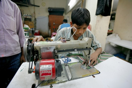 INDIA - FEB 26: Young textile worker in a small factory in Old Delh on February 26, 2008 in Delhi, India. Working age in this factory is from 16 to 71 years old. Stock Photo - 8945281