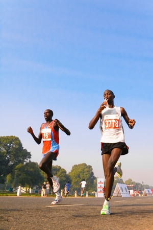 DELHI - OCTOBER 28: Man running alone in the marathon on October 28th, 2007 in Delhi, India.