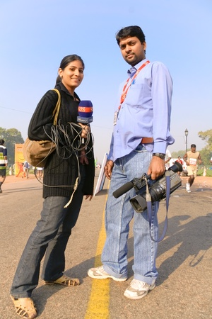 delhi: DELHI - OCTOBER 28: Young male and female TV reporters at Delhis Half Marathon on October 28, 2007 in Delhi, India. All main media cover this large 29,000 people strong event. Editorial