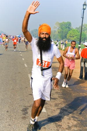 DELHI - OCTOBER 28: Middle aged bearded sikh man running marathon on October 28th, 2007 in Delhi, India. The 2009 event attracted around 29,000 runners from all walks of life.