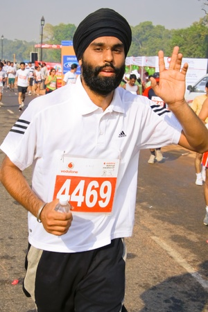 DELHI - OCTOBER 28: Young bearded Sikh man with turban competing in marathon on October 28, 2007 in Delhi, India. The 2009 event attracted around 29,000 runners.